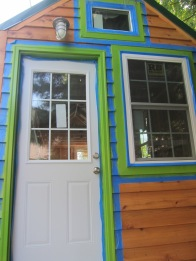 After staining the cedar, painting the window trim
