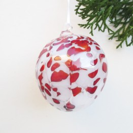 red and whtie spotted christmas blown glass ornament